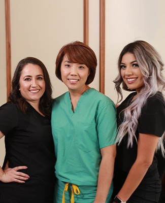 Dr. Kim and two dental team members