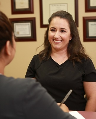 Team member smiling at dental patient