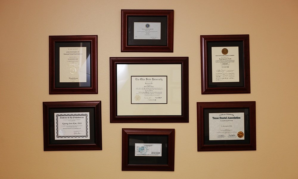 Dentists diplomas and certifications on wall